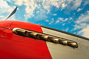 "Cowling and exhause detail of a P-51D ""Mustang"" fighter plane on the ramp at Atlanta's PDK airport.  Owned and operated by the Dixie Wing of the Commemorative Air Force."