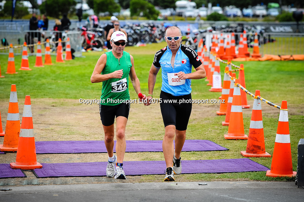 A blind para athlete heads out on the run leg of the Sovereign Tri Series, Waterfront, Wellington, New Zealand. Saturday 14 March 2015. Copyright Photo: Mark Tantrum/www.Photosport.co.nz