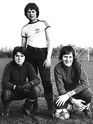 Three teenage friends pose after football practice in an Ealing park, London, UK, 1979.