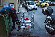 Athens, 23/01/2015: poor man searching in a dustbin, Exarhia