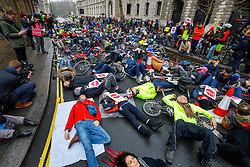 "© Licensed to London News Pictures. 11/02/2017. London, UK. Cyclists hold a ""die-in"" protest in Westminster, London following the deaths of Anita Szucs, 30 and Karla Roman, 32 both killed while cycling on Monday on the streets of London. Protesters asking for the government to commit to significantly increase funding for cycling and walking starting with 5% of the 2017 transport budget and increasing to 10% by 2020. Photo credit: Tolga Akmen/LNP"