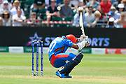 Hashmatullah Shahidi of Afghanistan ducks under a short pitched delivery from Nathan Coulter-Nile of Australia during the ICC Cricket World Cup 2019 match between Afghanistan and Australia at the Bristol County Ground, Bristol, United Kingdom on 1 June 2019.