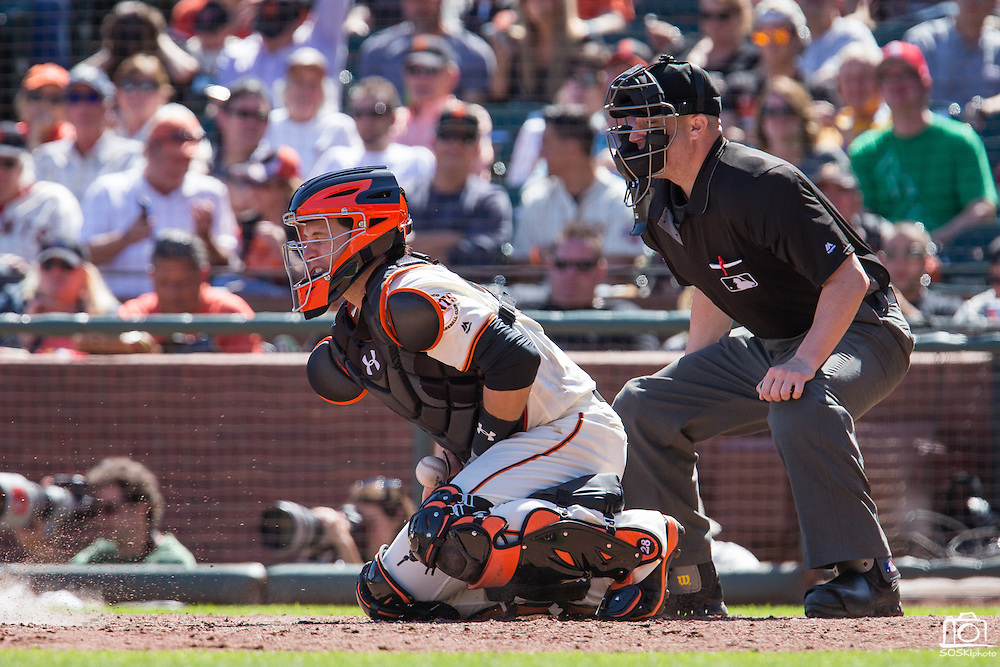 San Francisco Giants catcher Buster Posey (28) stops a wild pitch against the San Diego Padres at AT&T Park in San Francisco, Calif., on September 14, 2016. (Stan Olszewski/Special to S.F. Examiner)