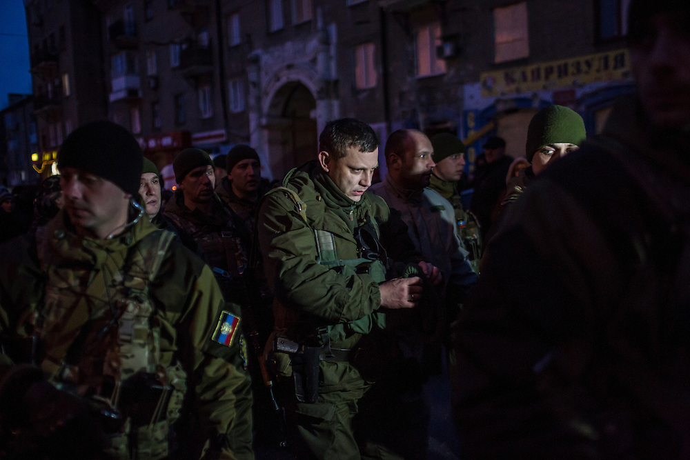 DONETSK, UKRAINE - JANUARY 24, 2015: Alexander Zakharchenko, center, Prime Minister of the self-declared Donetsk People's Republic, at a memorial event for victims of a rocket strike that hit a trolleybus two days earlier in Donetsk, Ukraine. The attack killed at least eight civilians and injured many more. CREDIT: Brendan Hoffman for The New York Times