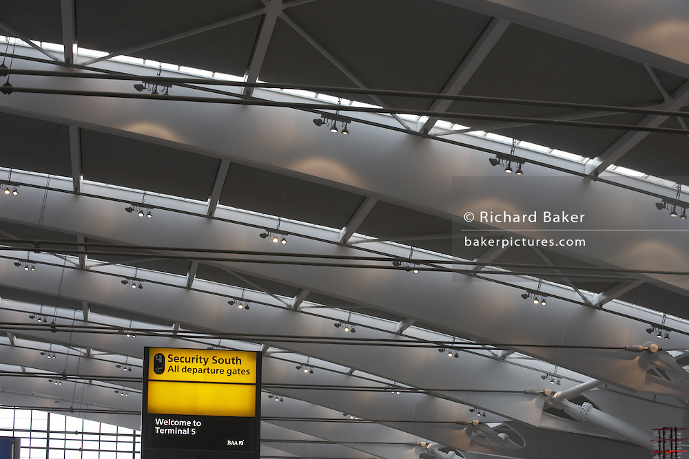 Looking upwards to security and departures sign in newly-opened London Heathrow Airport's Terminal 5 building.