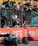 Mercedes team members celebrate driver Valtteri Bottas winning the Formula One U.S. Grand Prix auto race at the Circuit of the Americas on Sunday, Nov. 3, 2019, in Austin, Texas. NICK WAGNER / AMERICAN-STATESMAN