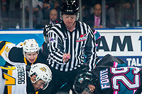KELOWNA, CANADA - NOVEMBER 3: Linesman Cody Wanner drops the puck between the Brandon Wheat Kings and the Kelowna Rockets  on November 3, 2018 at Prospera Place in Kelowna, British Columbia, Canada.  (Photo by Marissa Baecker/Shoot the Breeze)