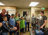 Coe College senior Kyle Hershey of Madison, Wisconsin surprises kids and parents with cereal flying off of the Van de Graaff generator during the 10th annual Playground of Science at Peterson Hall on the Coe College campus in Cedar Rapids on Thursday, October 25, 2012.