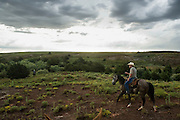 Woodward, OK - Justin Howard rides through his ranch in the Cherokee Strip looking for cattle.