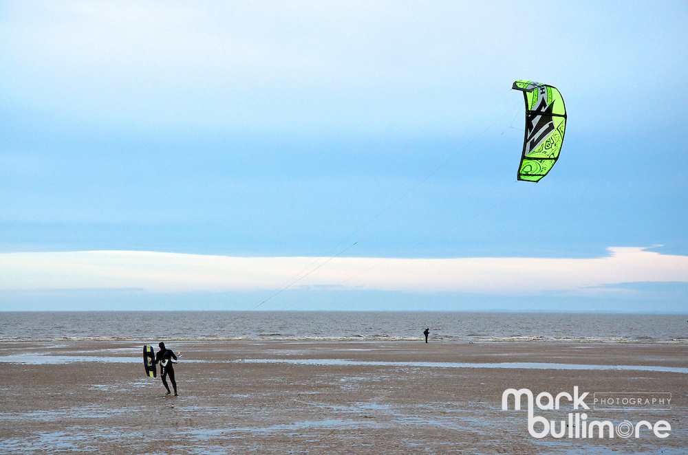Old Hunstaton, Norfolk, UK. 8th December 2013. Strong winds after the largest Storm surges in the UK provide great conditions for Kite Surfers at Old Hunstatnton Beach in North Norfolk.