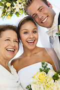 Bride and Groom With Mother on Beach