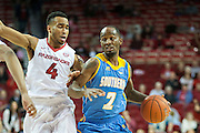 FAYETTEVILLE, AR - NOVEMBER 13:  Adrian Rodgers #2 of the Southern University Jaguars dribbles down the court while being guarded by Jabril Durham #4 of the Arkansas Razorbacks at Bud Walton Arena on November 13, 2015 in Fayetteville, Arkansas.  The Razorbacks defeated the Jaguars 86-68.  (Photo by Wesley Hitt/Getty Images) *** Local Caption *** Adrian Rodgers; Jabril Durham