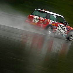 The RSR Motorsports Mini Cooper S driven by Chris Puskar and Dicky Riegel during the Grand-Am Continental Tire Sports Car Challenge ST race at Lime Rock Park in Lakeville, Conn.