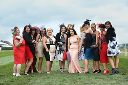 © Licensed to London News Pictures. 08/04/2016. Liverpool, UK. A group of women dressed to impress on Ladies Day at the Grand National 2016 at Aintree Racecourse near Liverpool. The race, which was first run in 1839, is the most valuable jump race in Europe. Photo credit : Ian Hinchliffe/LNP