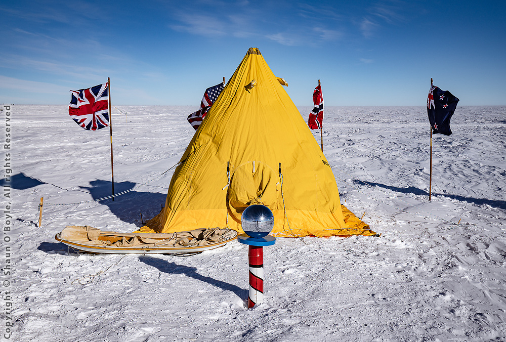 Ceremonial South Pole with the flags of the original signatories of the Antarctic Treaty flying. And a Scott tent, which is not something you would normally see set up at the Pole. A few hearty Polies camped out for the night. With 4 people in the tent they said it was reasonably warm, as high as zero in the tent.