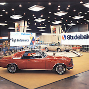 Studebaker's display a the 1963 Chicago Auto Show.  The Gran Turismo Hawk is shown with a non-stock paint scheme and wire wheels.