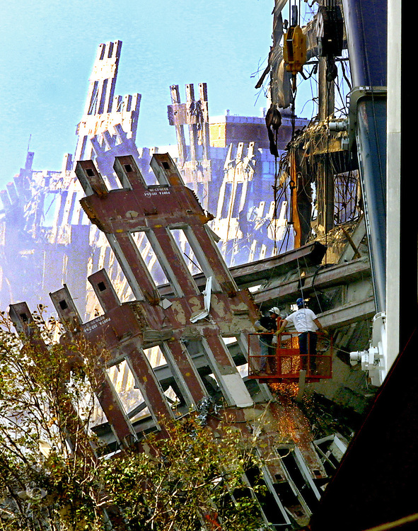Steel workers begin the lengthy process of dismantling the remains of the World trade Towers just days after the attacks. Rescue personnel could only wait until these large sections were cleared to search the areas below.