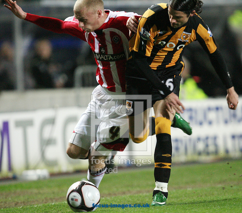 Hull - Thursday February 26th, 2009: Peter Halmosi of Hull City and David Cotterill of Sheffield United do battle for the ball during the FA Cup fifth round match replay at K.C Stadium, Hull. (Pic by Darren Walker/Focus Images)