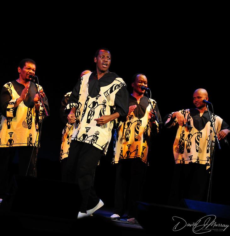 Ladysmith Black Mambazo member Ngane Dlamini (c)leaping and high kicking at The Music Hall, Portsmouth, NH