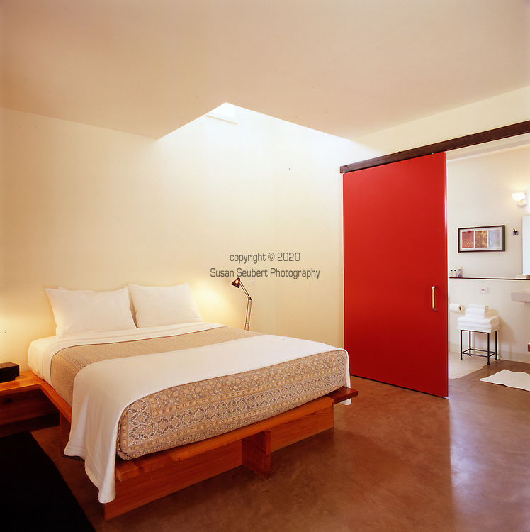 one of the suites at the San Jose Hotel, Austin, TX features modern furniture and a spacious bathroom