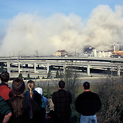 Crowd of people watch the Kingdome Sports Arena implosion at 8:30 am March 26, 2000, Seattle, Washington