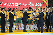 Mile Jedinak accept the Asian Cup trophy from Sepp Blatter after the AFC Asian Cup match at Stadium Australia, Sydney<br /> Picture by Steven Gibson/Focus Images Ltd +61 413 768835<br /> 31/01/2015