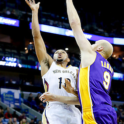 Nov 8, 2013; New Orleans, LA, USA;  New Orleans Pelicans shooting guard Eric Gordon (10) shoots over Los Angeles Lakers center Chris Kaman (9) during the second quarter of a game at New Orleans Arena. Mandatory Credit: Derick E. Hingle-USA TODAY Sports