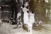 adult females playing on a swing 1918