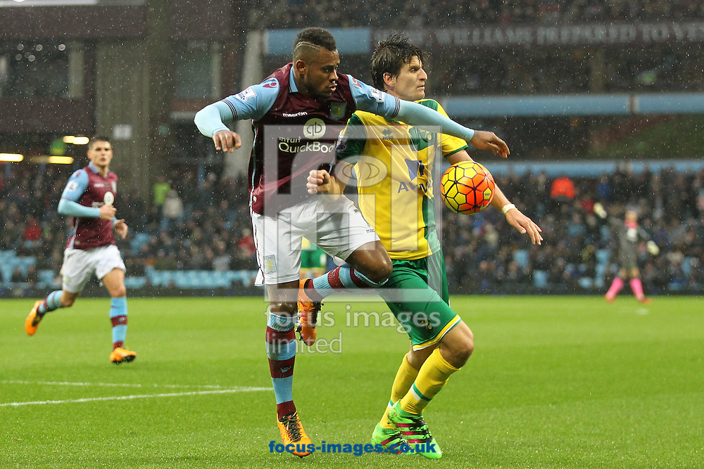 Leandro Bacuna of Aston Villa and Timm Klose of Norwich in action during the Barclays Premier League match at Villa Park, Birmingham<br /> Picture by Paul Chesterton/Focus Images Ltd +44 7904 640267<br /> 06/02/2016