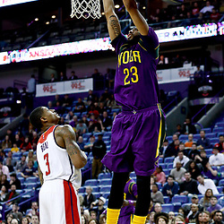 Jan 29, 2017; New Orleans, LA, USA; New Orleans Pelicans forward Anthony Davis (23) dunks over Washington Wizards guard Bradley Beal (3) during the second half of a game at the Smoothie King Center. The Wizards defeated the Pelicans 107-94. Mandatory Credit: Derick E. Hingle-USA TODAY Sports