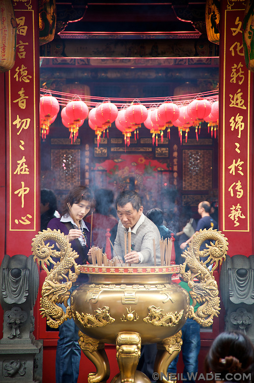 Many visitors take time to pray at the Wuchang Taoist Temple inside the National Center for Traditional Arts.