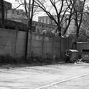 A mother and child in the Serbian enclave in Kosovo. The lives of the Serb population left in the enclave are confined within the wall and precinct defined.
