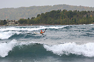 An expert sea kayaker in large waves on Lake Superior in Marquette Michigan in the Upper Peninsula.