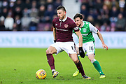 Manuel Milinkovic (#11) of Heart of Midlothian passes the ball away under pressure from Lewis Stevenson (#16) of Hibernian during the William Hill Scottish Cup 4th round match between Heart of Midlothian and Hibernian at Tynecastle Stadium, Gorgie, Scotland on 21 January 2018. Photo by Craig Doyle.