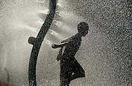 Youngsters kept cool in the spray of a sprinkler at Audrey Carey Park in the City of Newburgh, NY on Friday, July 9, 2010. The Northeast U.S. has endured a heatwave during the past week, with temperatures occasionally reaching past 100ºF.