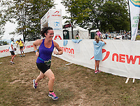 Gretchen Gandini of Gilford begins the 13 mile run portion for her relay team during the 70.3 Timberman Triathlon on Sunday with her teammates Martha and Jane Clement (Karen Bobotas/for the Laconia Daily Sun)