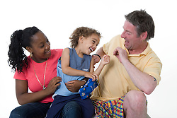 Man tickling a young child to try and cheer him up,