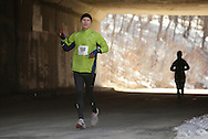 Mamakating, New York - A man runs through a tunnel during the Wurtsboro Mountain 30K road race on March 20, 2011.