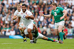 England replacement Billy Vunipola is tackled by Ireland replacement Richardt Strauss - Mandatory byline: Rogan Thomson/JMP - 07966 386802 - 05/09/2015 - RUGBY UNION - Twickenham Stadium - London, England - England v Ireland - QBE Internationals 2015.