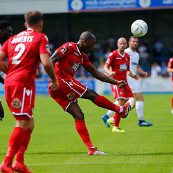 Wrexhams defender Emanuel Smith clears the ball during the opening National League match between Dover Athletic and Wrexham FC at Crabble Stadium, Kent on 04 August 2018. Photo by Matt Bristow.