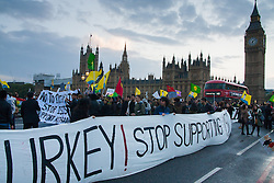 Westminster, October 9th 2014. British Kurds block Westminster Bridge as scores of Kurds demonstrate against ISIS and demand that the UK and Turkey assist them in defending themselves against the Jihadist movement.