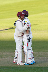 James Hildreth of Somerset celebrates with Luke Ronchi after making a century in the first innings - Mandatory byline: Rogan Thomson/JMP - 07966 386802 - 22/09/2015 - CRICKET - The County Ground - Taunton, England - Somerset v Warwickshire - Day 1 - LV= County Championship Division One.