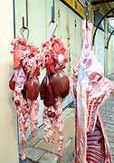 Fresh Meat hanging from a rack in a small family run Butcher shop. Photographed in Nazareth, Israel