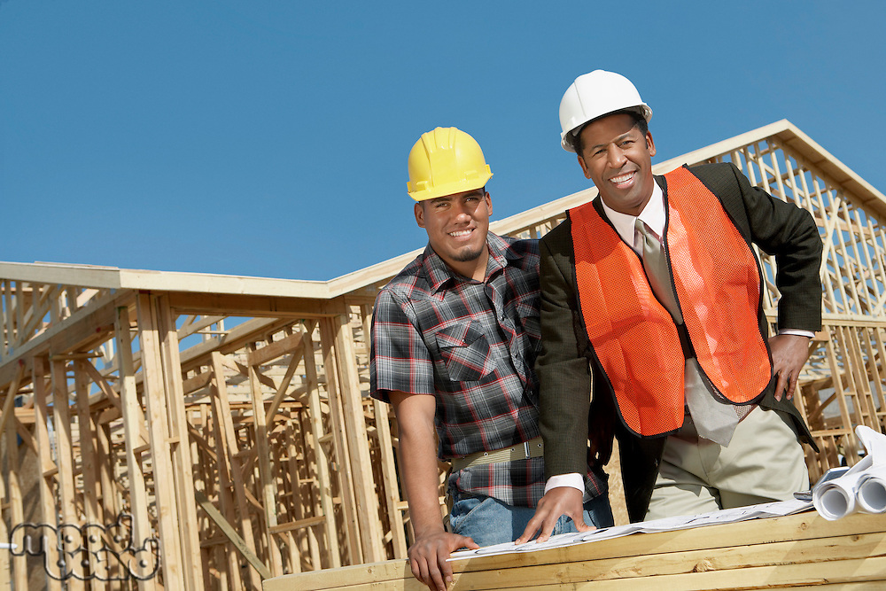 Surveyor and Construction Worker on Site
