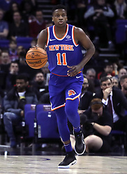 New York Knicks' Frank Ntilikina wears a pair of Nike's first ever self lacing shoes during the NBA London Game 2019 at the O2 Arena, London.