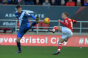 Birmingham City defender Jonathan Grounds and Bristol City midfielder Luke Freeman stretch for the ball during the Sky Bet Championship match between Bristol City and Birmingham City at Ashton Gate, Bristol, England on 30 January 2016. Photo by Alan Franklin.