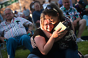 After having heard her raffle number called for a brand new $265,000 Coeur d'Alene home at the NIC Foundation Really Big Raffle Joyce Broemmeling, left, frantically hugs her close friend Jayne Peterson, right, Wednesday evening outside the NIC Student Union Building.