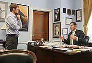Representative Bruce Braley (D-IA) talks with his Communications Director Jeff Giertz in his office in the Rayburn House Office Building in Washington, DC on Wednesday, April 10, 2013.