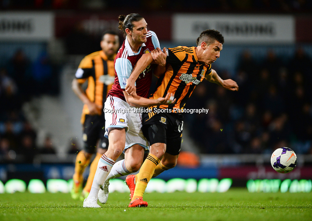 26 March 2014 - Barclays Premier League - West Ham United v Hull City - Andy Carroll of West Ham United tangles with Jake Livermore of Hull City - Photo: Marc Atkins / Offside.