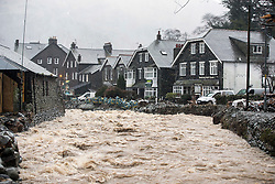 © Licensed to London News Pictures. 26/01/2016. Glenridding UK. A torrent of water is flowing through the beck this morning in Glenridding, the village that flooded three times in December. Photo credit: Andrew McCaren/LNP